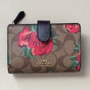 NWT Coach floral zip wallet in signature canvas